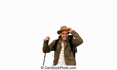 Cheerful man raising his hat on whi