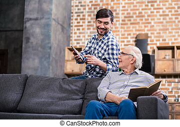 Cheerful man resting with his father