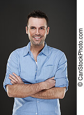 Cheerful man smiling with arms crossed