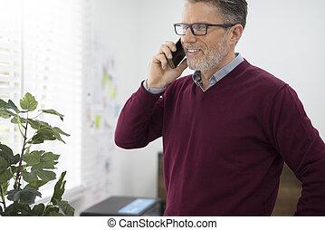 Cheerful man talking on the phone