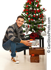 Cheerful man with Christmas gifts