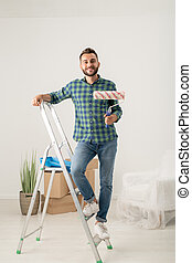 Cheerful man with paint roller