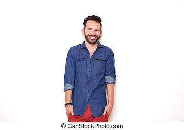 Cheerful mature man standing with hands in pocket