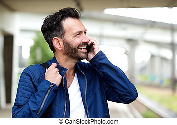 Cheerful mature man talking on mobile phone
