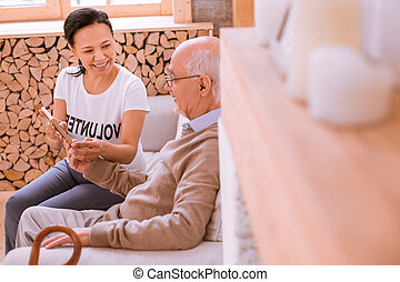 Cheerful mature man telling stories about his family