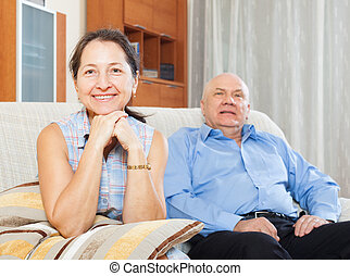 cheerful mature woman against elderly man