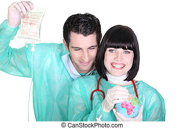 cheerful medical duo wearing blouse with globe