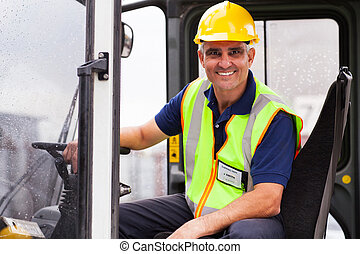 middle aged forklift operator - cheerful middle aged ...