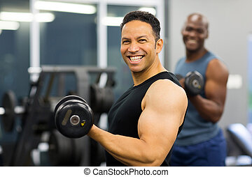 middle aged man lifting weights