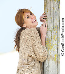 Cheerful middle aged woman smiling outdoors