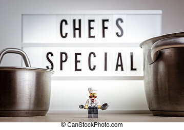 Cheerful miniature chef. Chef's special concept. Illustrative editorial. September 02, 2021