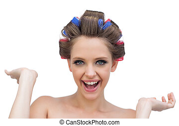 Cheerful model posing with hair curlers