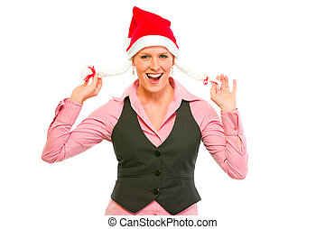 Cheerful modern business woman in Santa Hat
