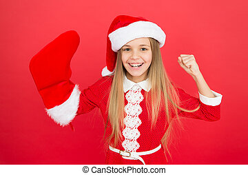 Cheerful mood. Christmas party. Winter holidays. Playful mood. Christmas celebration ideas. Child Santa Claus costume hold stocking. Happy smiling face. Emotional baby. Good vibes. Positivity concept