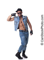 Cheerful muscular male model posing in denim suit