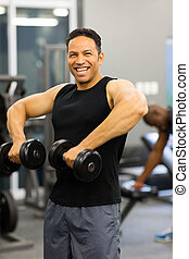 man exercise with dumbbells