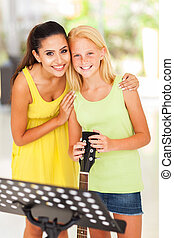 music teacher with preteen girl after music lesson
