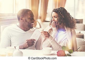 Cheerful nice woman sitting with her boyfriend