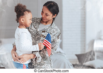 Cheerful nice woman wearing a military uniform