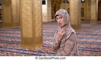Cheerful Nun Inside the Islamic Mosque Shows Funny Poses and...
