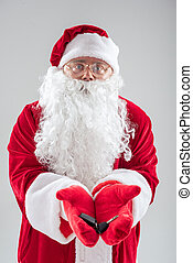 Cheerful old Santa Claus presenting keys of car