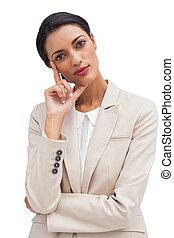 Cheerful pensive businesswoman standing