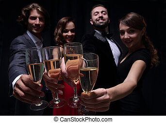 Cheerful people celebrating a sucess with Champagne