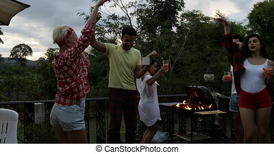 Cheerful People Dancing Having Barbecue Party On Summer...