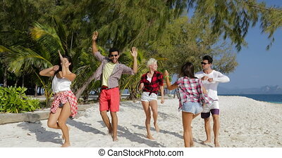 Cheerful People Dancing On Beach, Mix Race Men and Women ...