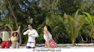 Cheerful People Dancing On Tropic Beach, Mix Race Men and...