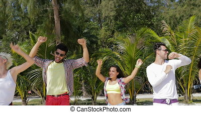 Cheerful People Dancing On Tropic Beach, Mix Race Men and ...