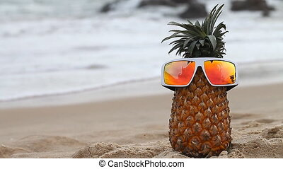 Cheerful pineapple on vacation, travel, relaxation and...