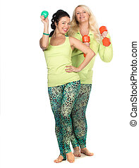 Cheerful plus size women posing with fit equipment