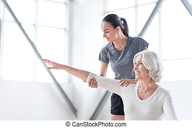 Cheerful positive woman stretching out her arm