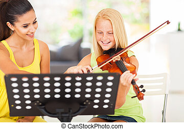 pre teen girl enjoying her violin lesson