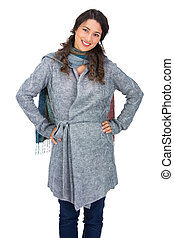Cheerful pretty brunette wearing winter clothes posing