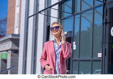 cheerful pretty girl in fashion sunglasses