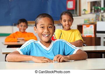 Cheerful primary school children - Three cheeful young...