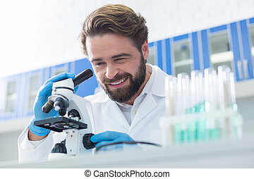 Cheerful professional scientist smiling