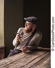 Cheerful retro guy is relaxing with cigarette