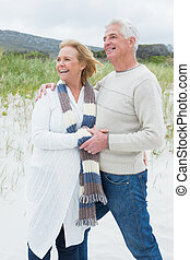 Cheerful romantic senior couple at beach