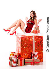 cheerful santa girl with gift boxes
