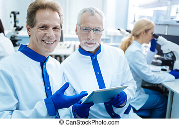 Cheerful scientist sharing opinions about analysis results -...