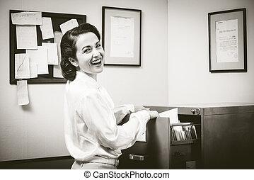 Cheerful secretary at work