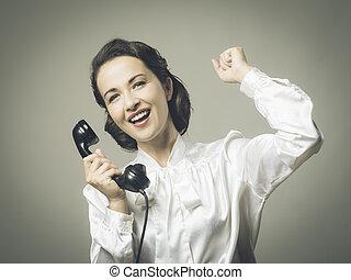 Cheerful secretary on the phone