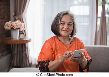 senior asian woman using her smart phone