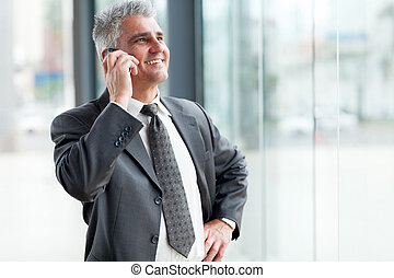 senior businessman talking on cell phone