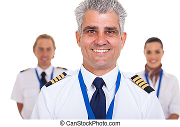 senior captain standing in front of airline crew