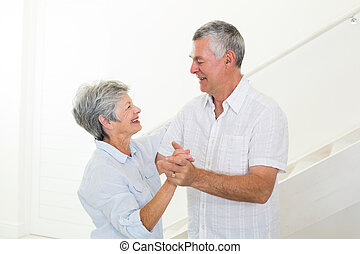 Cheerful senior couple dancing together