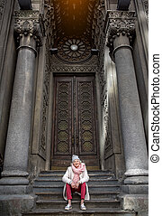 Cheerful senior lady is interested in ancient architecture